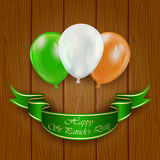 Patricks day balloons on wooden background Royalty Free Stock Photo