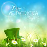 Patricks Day and green hat of leprechaun in grass on sky backgro Royalty Free Stock Photos