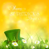 Patricks Day and green hat of leprechaun in grass on yellow sunn Royalty Free Stock Photography