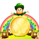 Patricks day leprechaun stands near golden coin Stock Photo
