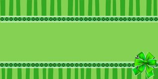Patricks Day rectangle template with shamrocks lace and  bow. Saint Patricks Day rectangle template with shamrocks lace, festive bow and copy space on green Royalty Free Stock Photos