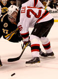 Patrik Elias New Jersey Devils. New Jersey Devils forward Patrik Elias (26) takes the face-off with Boston Bruins center Patrice Bergeron (37 Royalty Free Stock Photo