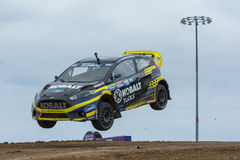 Patrik Sandell rally driver jumps. San Pedro, CA - September 20, 2014:Patrik Sandell rally driver jumps at the Red Bull GRC Global Rallycross at the Port of Los Royalty Free Stock Photography