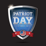 Patriot day september 11, 2001. American flag words patriot day september 11, 2001 on shield Royalty Free Stock Photos