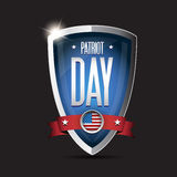 Patriot day september 11, 2001. American flag words patriot day september 11, 2001 on shield Stock Images
