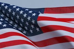 Patriot dreams. The star spangled banner flying in the wind Stock Image