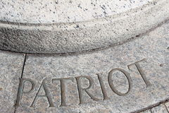 Patriot. Etched in granite stone on a sidewalk in boston Stock Photos
