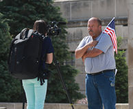 Patriot is interviewed  at Rally to Secure Our Borders Stock Photography
