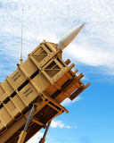 A Patriot Missile. Poised in its Launcher Against a Cloudy Sky stock images