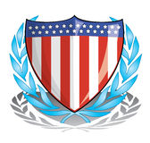 Patriot Shield. Illustration of a shield emblazoned with the US flag, surrounded by a laurel wreath, cast shadows Royalty Free Stock Image