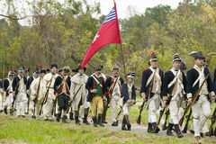 Patriot soldiers with flags march to Surrender Field as part of the 225th Anniversary of the Victory at Yorktown, a reenactment of Royalty Free Stock Image