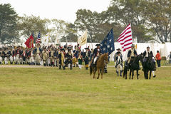 Patriot soldiers march to Surrender Field as part of the 225th Anniversary of the Victory at Yorktown, a reenactment of the siege  Royalty Free Stock Image
