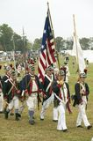 Patriot soldiers march to Surrender Field as part of the 225th Anniversary of the Victory at Yorktown, a reenactment of the siege. Of Yorktown, where General Stock Image