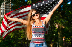 Patriot woman holding the United State flag Stock Photos