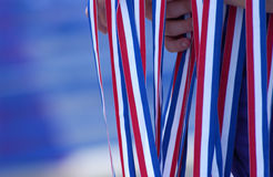 Patriotic. Hands holding red white and blue ribbons Royalty Free Stock Photography