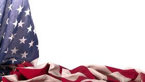 American flagged draped over itself with a black background. Patriotic American flag beautifully draped over itself around the left side and bottom corner royalty free stock photo