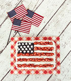 Patriotic American flag cake with mini flags Royalty Free Stock Photo
