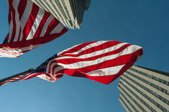 Patriotic American Flag Overhead. The United States Flags flow patriotically in unison in the wind overhead. Scene shot in the Radio City Center area within Stock Photos