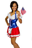 Patriotic American Girl. Patriot in stars and stripes costume.  Young African American female holding two flags Royalty Free Stock Images