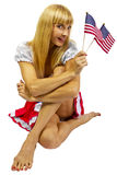 Patriotic American Girl with two flags. Isolated on a white background Stock Image
