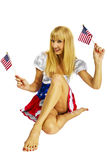 Patriotic American Girl with two flags. Isolated on a white background Royalty Free Stock Photo