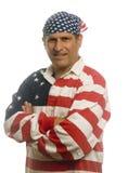 Patriotic American man wearing flag shirt Stock Images