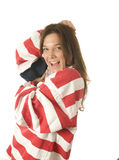 Patriotic American woman with USA flag Stock Photo