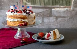 Patriotic angel food cake with berries royalty free stock images