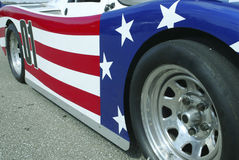 Patriotic Auto. Detailed view of the side of a race car painted in stars and stripes Stock Photography