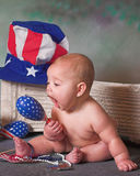 Patriotic Baby. Baby girl playing with patriotic props Royalty Free Stock Image