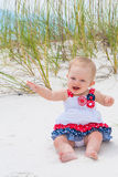 Patriotic Baby Girl at the Beach Stock Image