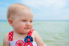 Patriotic Baby Girl at the Beach. July 4th Patriotic Baby Girl at the Beach Stock Image