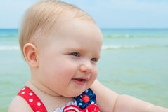 Patriotic Baby Girl at the Beach. July 4th Patriotic Baby Girl at the Beach Stock Photo