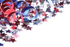 Patriotic background. Red, white and blue stars and ribbons on white background with copy space stock photos