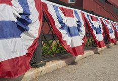 Patriotic banners on railing Stock Photography