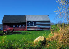 Patriotic Barn with American flag Stock Image