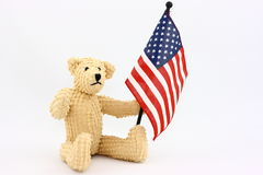 Patriotic Bear. It's our little bear friend again. This time he's ready for the 4th of July parade with his own American flag Royalty Free Stock Image