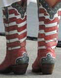 Patriotic boots. Red , white and blue boots, kicking up the 4th Royalty Free Stock Images