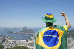 Patriotic Brazil Fan Standing Wrapped in Brazilian Flag Rio Royalty Free Stock Image