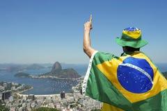 Patriotic Brazil Fan Standing Wrapped in Brazilian Flag Rio Stock Image