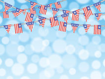 Patriotic bunting flags on bokeh background Stock Photos