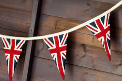Patriotic bunting. Union flag bunting against wooden wall Stock Images