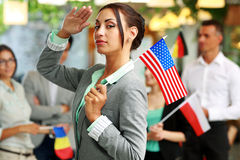 Patriotic businesswoman standing with USA flag Stock Photos