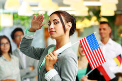 Patriotic businesswoman standing with USA flag Royalty Free Stock Photos