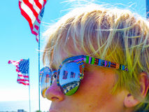Patriotic California Boy Wearing Sunglasses Overlooking Malibu Beach. Boy looking out to the Pacific Ocean and world-famous Malibu beach on the Pepperdine Stock Photos