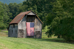 Patriotic celebration II. Old barn with American flag stock images