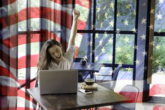 Patriotic composite of happy young half Thai-American woman in h Royalty Free Stock Images