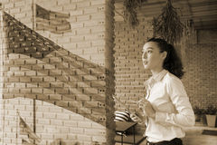 Patriotic composite of happy young half Thai-American woman in h Stock Image
