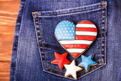Patriotic cookie on a back pocket of jeans Stock Photos