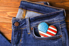 Patriotic cookie on a front pocket of jeans Stock Photos